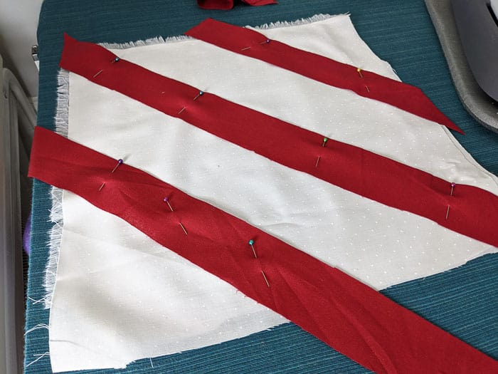 Pinning the stripes in place to create a candy cane effect.