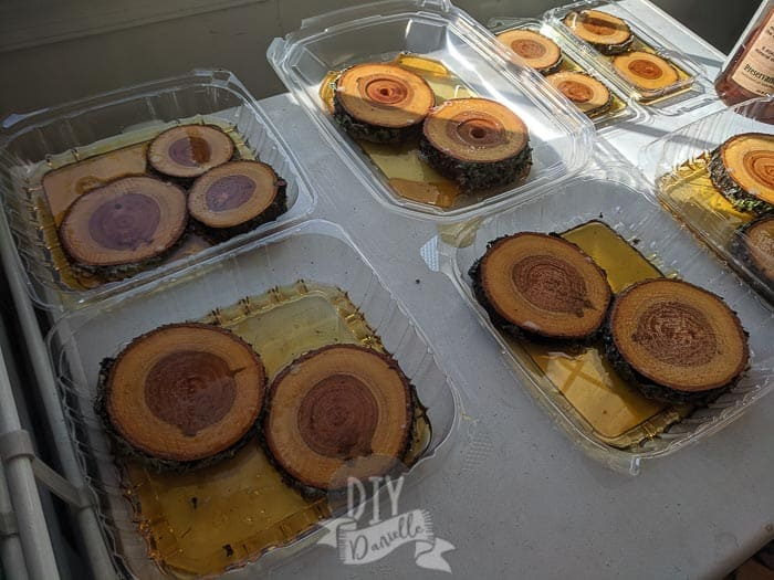 Preparing the wood slices by soaking them in stabilizer.