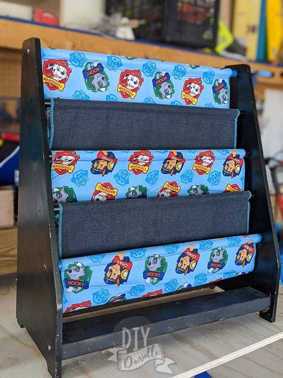 Repaired sling wood book rack with new Paw Patrol fabric to match my son's room.