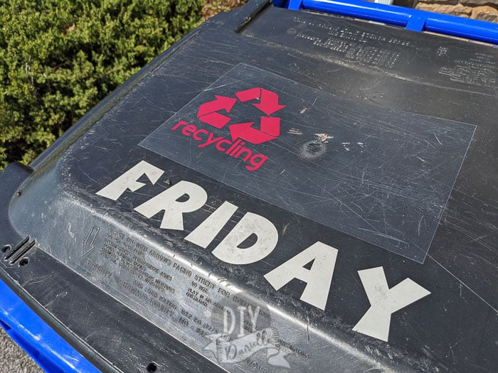 Recycling bin with a label for recycling AND for the day of the week the recycling is picked up.