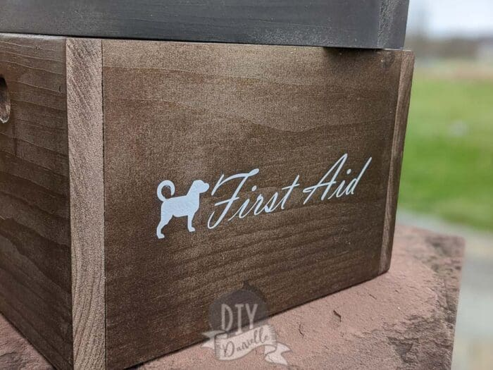 """First Aid"" supply box for my dog that was labeled using white Cricut Iron On Vinyl."