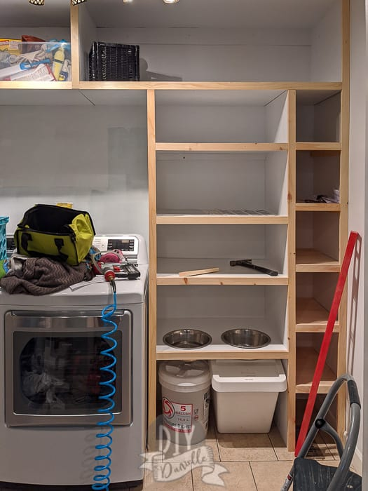 Adding 1x2s for trim to the front of the shelves.