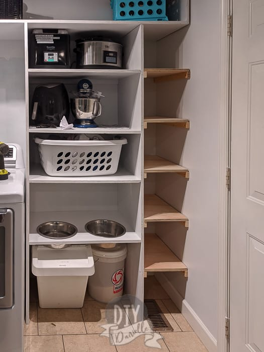 The pantry shelf on the left with appliances on it. The shoe shelf for the mudroom shelf on the right.