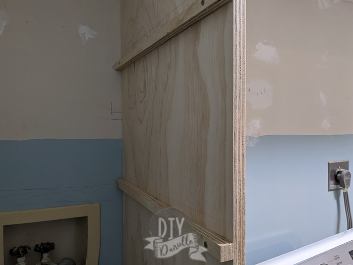 Adding supports for the laundry shelves.