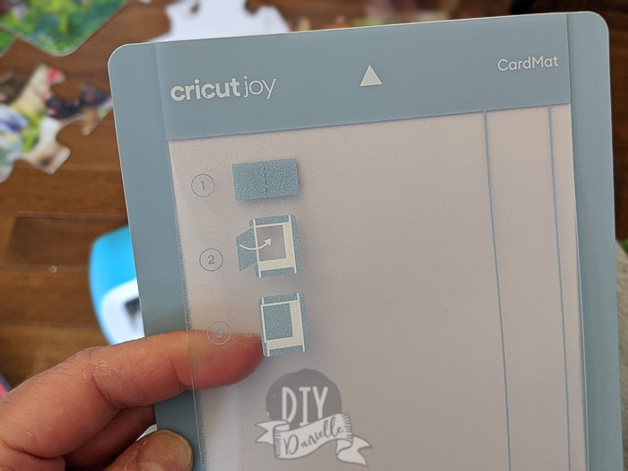 The special card mat for the Cricut Joy has a top layer to separate the layers of your card while cutting.