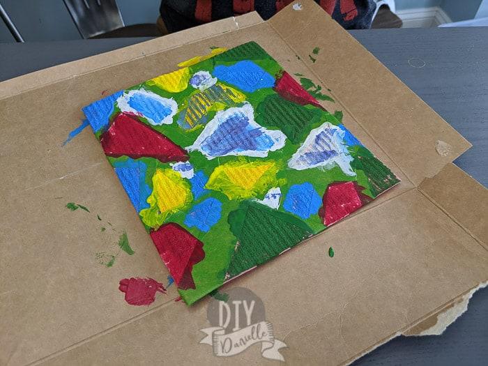 Painting a Swedish dishcloth with acrylic paint.