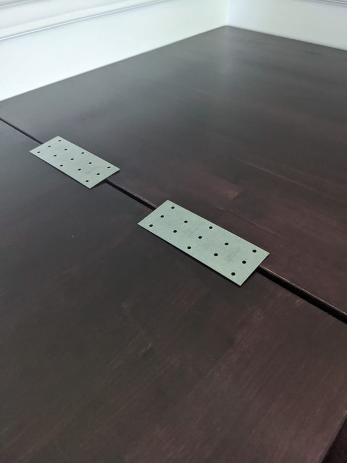 Two galvanized tie plates on top of the desk. These were screwed in UNDER the desk to hold the two pieces of butcherblock together for the L shaped desk.