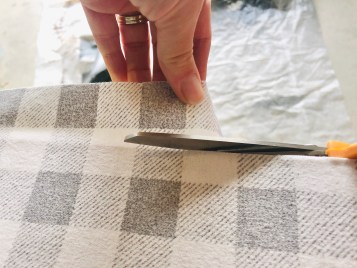Cutting the fabric edges off.