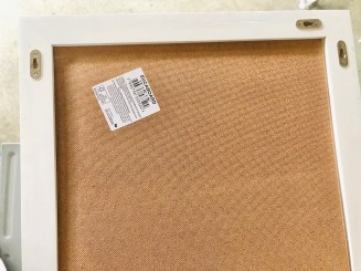 Attaching the board to a store bought frame.