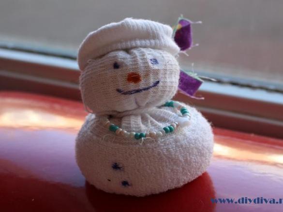 Permalink to:Sneeuwpop maken van een sok