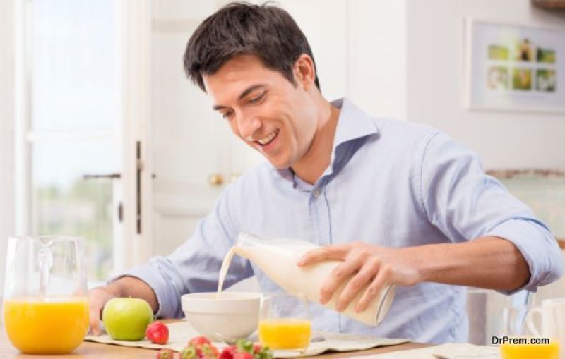 Man Having Breakfast With Milk