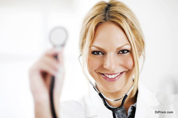 Portrait of successful doctor showing her stethoscope.