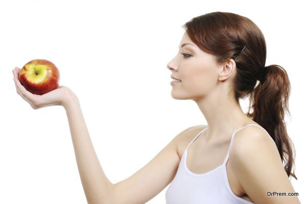 beautiful woman with apple - isolated on white background
