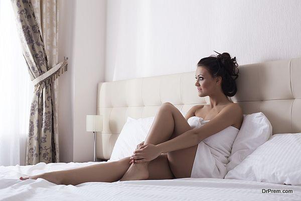 Image of beautiful woman looking at window