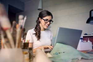 happy place at home photo of woman using her laptop