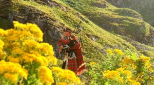 bagpipe player in the highlands