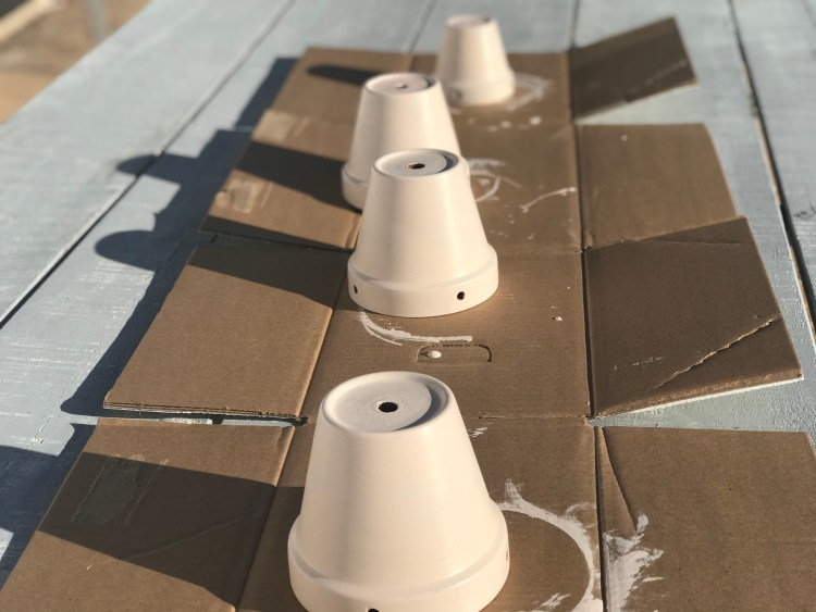 Paint and seal the planters for the DIY Hanging Planter Decor