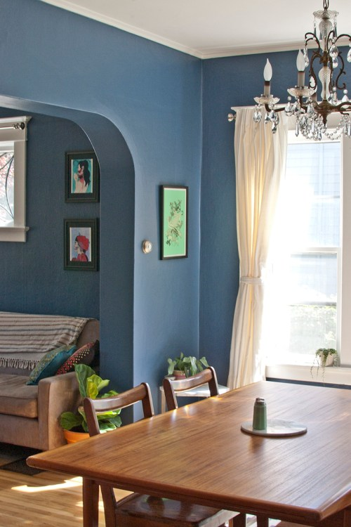 Dark blue dining room/living room with complementary colors