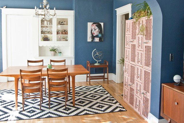 Navy blue dining room with blush pink lockers and Ikea rug