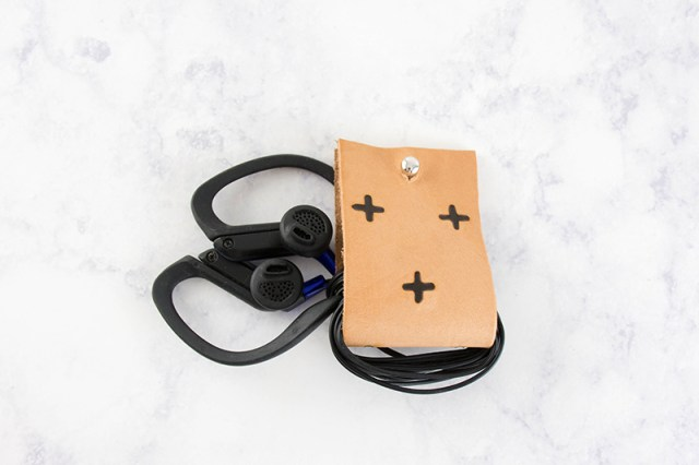 Tired of tangled cords? Make your own leather DIY earbud holder.