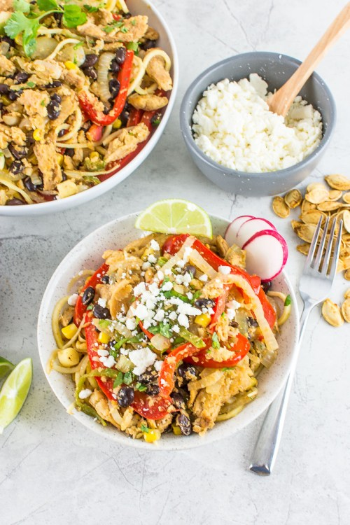 This southwestern sweet potato noodle bowl is made with spiralized sweet potatoes, and tons of veggies. It's vegetarian, but leave off the cheese, and it's vegan.