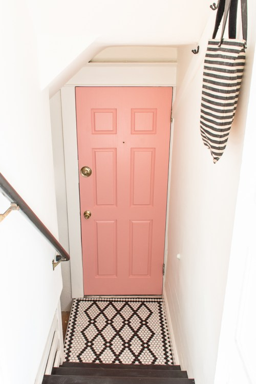 Jumping on the colorful door trend with my pink door. This door was terrible before, but paint made a big difference for the better! #pinkdoor #colorfuldoor