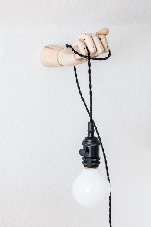 Make a playful DIY hand sconce light fixture to hold your light. #decor #DIY #homedecor #home #lighting