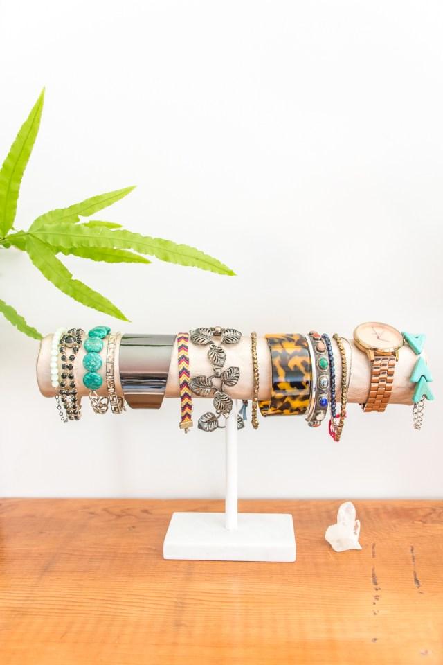 This DIY bracelet storage display is an elegant, simple way to organize your jewelry. #DIY #organization #jewelry #DIYjewelry #homedecor