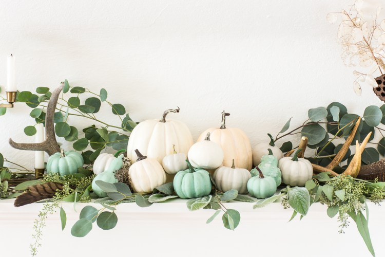 Fall mantel with eucalyptus, and white and jade pumpkins