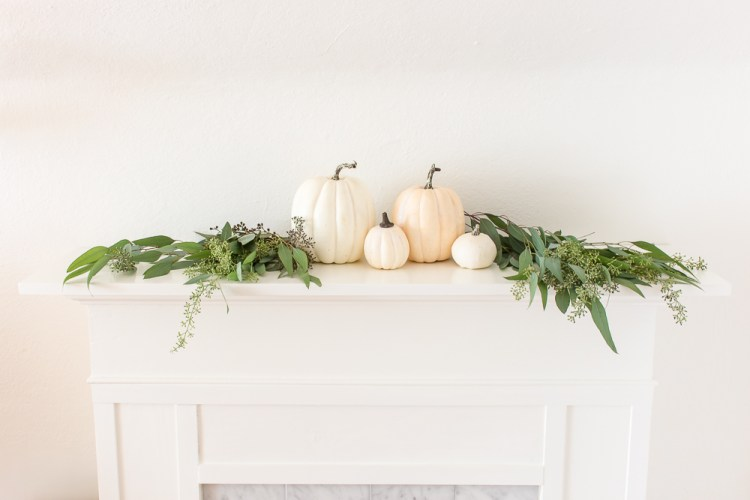 Fall mantel with eucalyptus, and white pumpkins