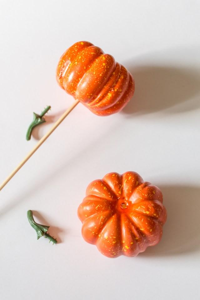 Skewered fake pumpkins for painting