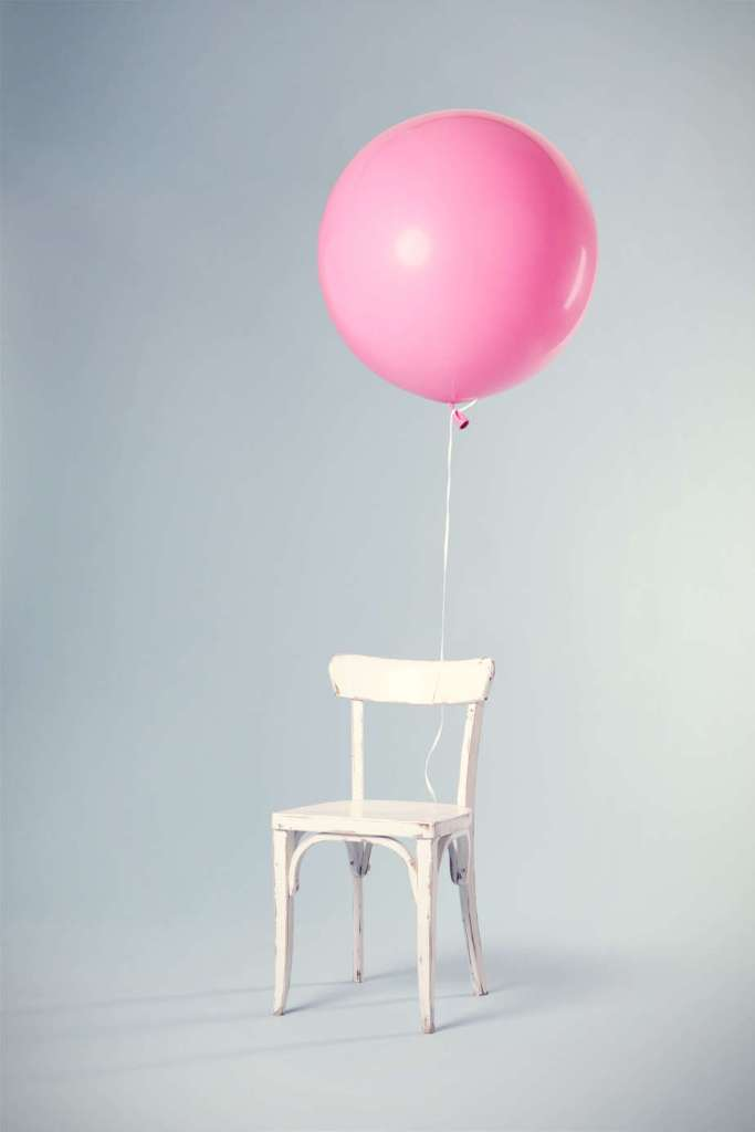 Pink balloon tied to a chair