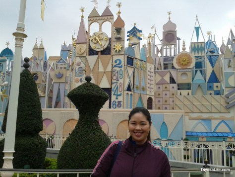 Ria outside the Its a Small World Ride outside of Disneyland HK
