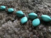 I started hooking the beads together in a straight line and adding the design from there.