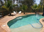 Timber pool fence with aluminium infill