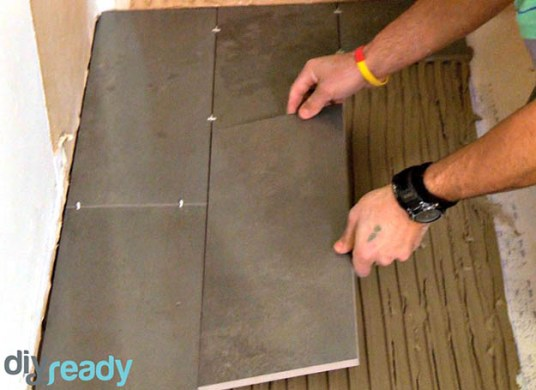 How to Lay Tile in Bathroom DIY Projects Craft Ideas   How To s for     Place the Tiles   Clean Your Floor   How to Lay Tile in Bathroom   How