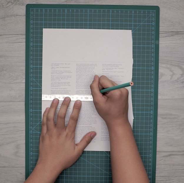 Step 3: Measure That Same Length Onto The Page From Your Book | How To Make A DIY Pencil Holder
