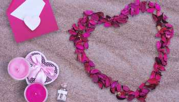 Flower heart beside candle and letter in the sand | DIY Valentine Gifts You Can Make In Under An Hour | diy valentine gifts | Featured