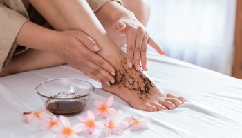 person applying foot scrub | DIY Foot Scrub Recipe For Your Own Home Spa | featured