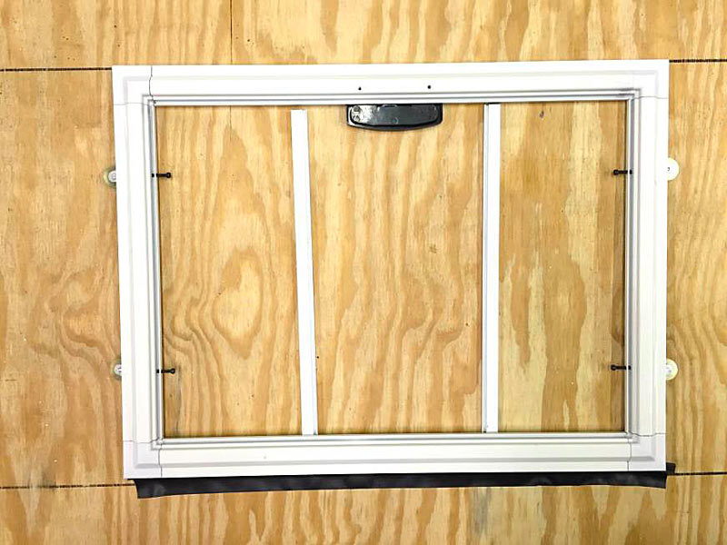 C) Lay The Screen Cloth Over The Door Frame, Overlapping The Frame On All  Four Sides Of The Frame