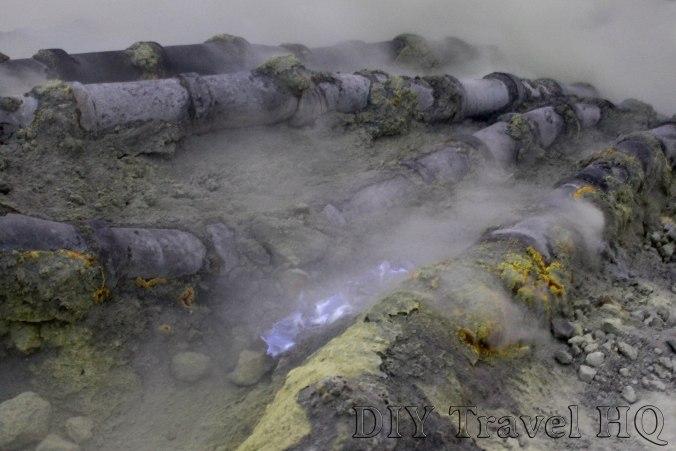 Volcanic gases produce blue flames & sulphur
