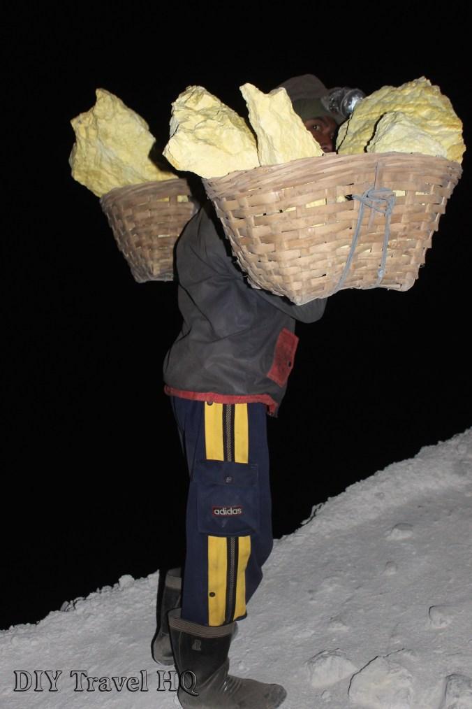 Passing a miner on the night trek up Mt Ijen
