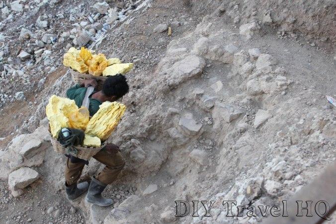 Miner carrying baskets of sulphur on Mt Ijen