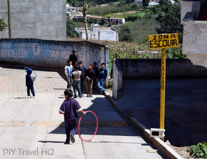 Laguna Chicabal School Children Playing with Hula Hoops