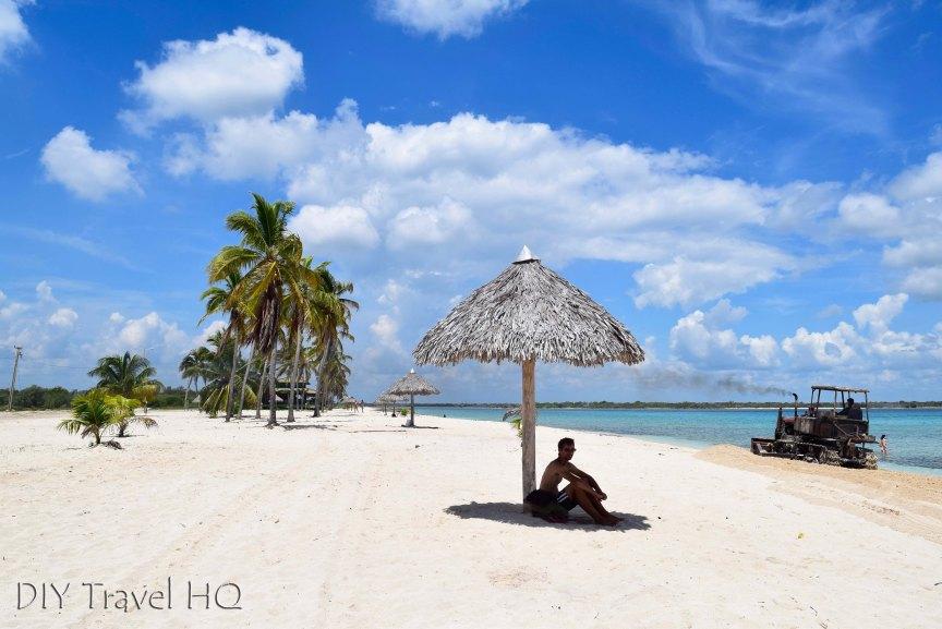 Playa los Cocos Sun Umbrellas with Bulldozer Leveling Beach