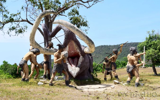 Cavemen spearing a wooly mammoth