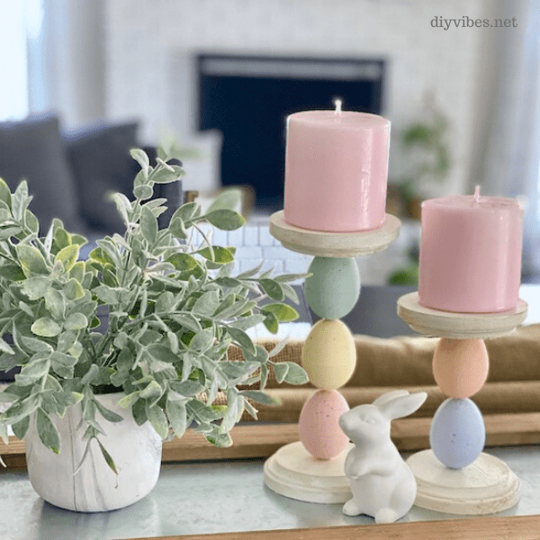 easter egg candle holders on tray with plant and ceramic bunny