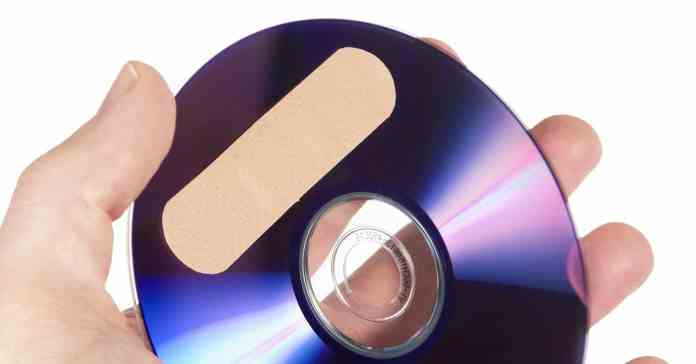 Image of a DVD with a sticking plaster on it suggesting disc recovery software solutions.