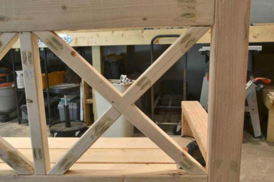 DIY a large porch bench for enjoying those long summer nights and crisp fall days.