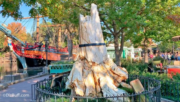 Petrified Tree in Frontierland Disneyland with the Columbia sailing ship in background